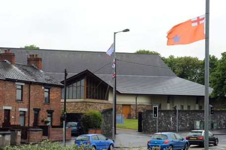 Paramilitary flags around the Woodburn Road area where St Nicholas? Church and St Nicholas? Primary School are located
