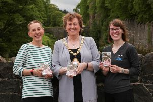 Launching the wildlife guide to the Glenarm coastline are Jacky Geary, chair of Glenarm Wildlife Group, the Mayor of Mid and East Antrim, Cllr Maureen Morrow, and Gala Podgorni.