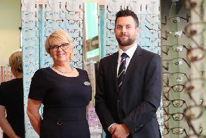 Deirdre McAree and Darren Caulfield of Specsavers Larne.