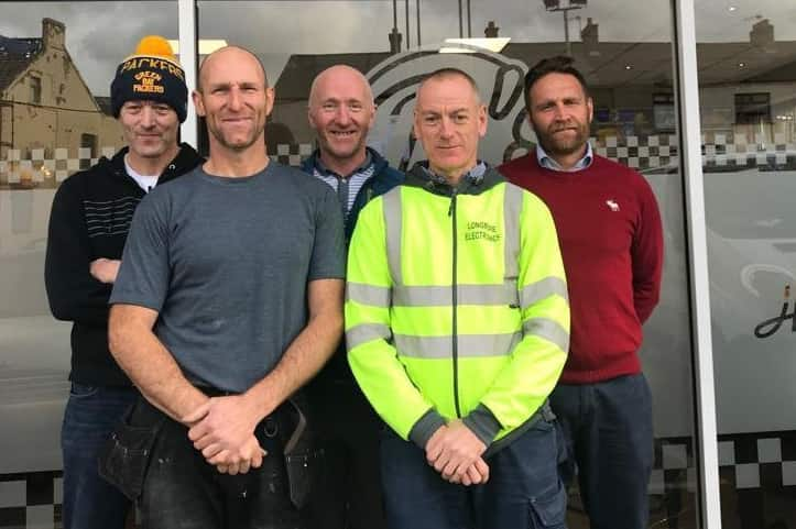 Danny Hylands (front left) and his support team.