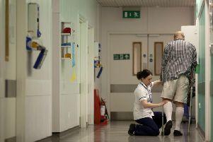 A nurse helping a patient