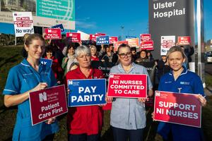 (left to right) MAU nurse Catherine Gallagher, Dermatology and Neurology ward sister Joanne Knight, health care assistant Jenny McBride, and MAU nurse Lynsey Strain support members of the Royal College of Nurse (RCN) and supporters outside the Ulster Hospital begin industrial action on safe and effective care in Northern Ireland. PA Photo. Picture date: Tuesday December 3, 2019.