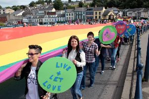A previous Foyle Pride Parade making its way into the city centre.