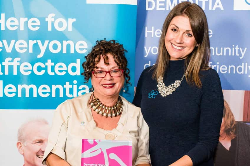 Ald. Gerardine Mulvenna with her Outstanding Contribution of the Year award and event host Sarah Travers.