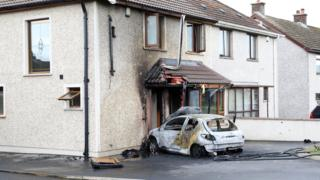 The stolen car was set on fire outside the house